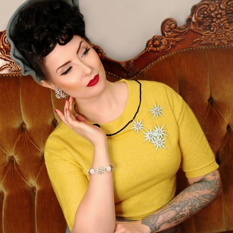 Yellow knit top with black velvet decorations