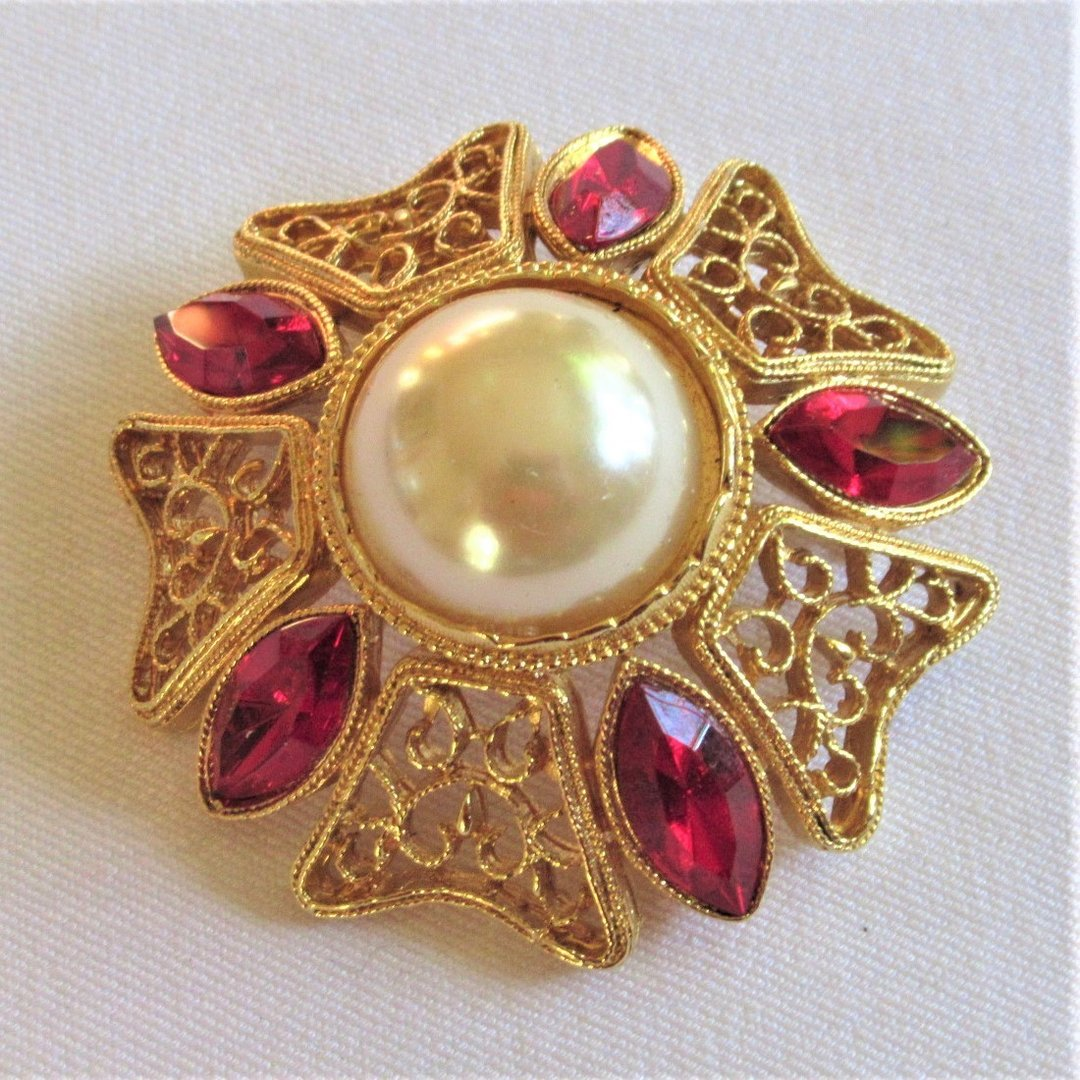 Gold-colored filigree brooch, 80s